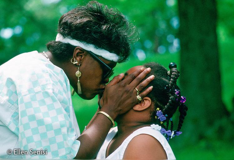MR/ Schenectady, New York.Mother, daughter (6) kiss. Scan from older film; may not be appropriate for highest resolution print publication usage..MR:  Fra1, Fra2      FC#:10302-00401.© Ellen B. Senisi