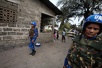 Indian female Peacekeepers from the Indian FPU ( formed police unit ) patrol while providing armed  support to the liberian national police  during a cordon and search operation in Monrovia, Liberia on Monday March 19 2007. .103 Indian police personnel  were specially selected to take part in the UNMIL peacekeeping mission in Liberia for an initial deployment of 6 months. .They are the first contingent entirely formed by women in the history of the United Nations Peacekeeping..their mission in the country is to provide fire support to the unarmed liberian security forces. In india these women distinguished themselves by operating in the most troubled areas of the country taking part in counter insurgency and crowd control special operations.