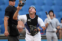 Dunedin Blue Jays catcher Sean Ochinko #14  looks for a foul ball in front of umpire Brett Terry during a game against the Tampa Yankees at Dunedin Stadium on April 28, 2012 in Dunedin, Florida.  Dunedin defeated the Yankees 6-1.  (Mike Janes/Four Seam Images)