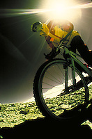 Man mountain biking in winter in Rocky Mountains of Colorado. Photographed in infrared color. Chad Damico (MR 700). Colorado.