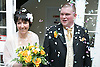 Bride and groom being showered with confetti after taking marriage vows at a registry office wedding,