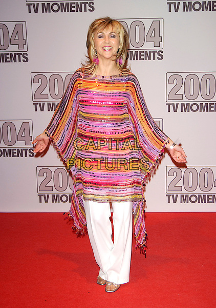 "LESLEY GARRETT.""2004 TV Moments Awards Ceremony"" .at BBC Television Centre.London 22 January 2005.full length multi-coloured poncho top striped sequined.www.capitalpictures.com.sales@capitalpictures.com.©Capital Pictures"