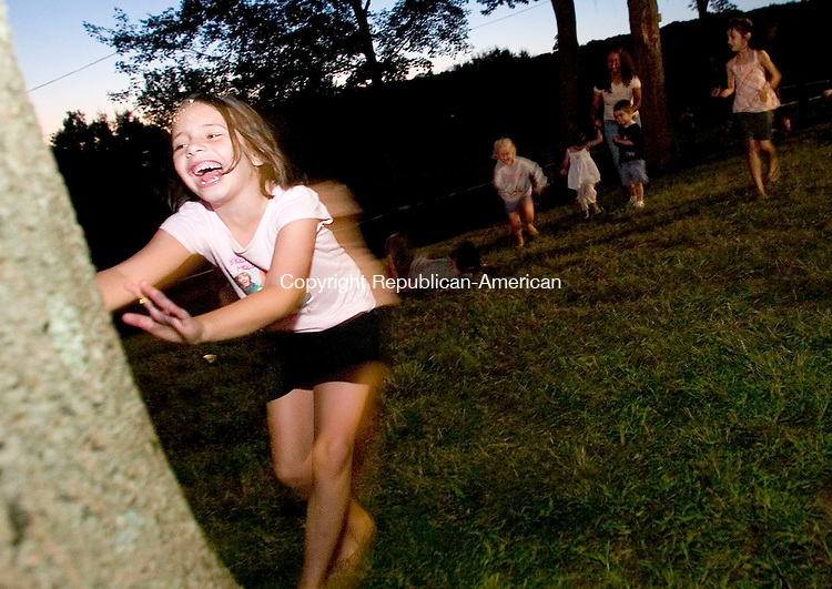 WATERBURY, CT- 05 AUG 2007- 080507JT09- <br /> Alyssa Parrillo, 6, of Waterbury, gets a head start on racing to a tree at the Pontelandolfo Club on Sunday night, leaving in the background, from left, Lillian LaChance, 4, Ashley Parrillo, 2, Ileana Maia, Cameron Primus, and Isabella Primus, 7, during the club's 21st annual Festa di San Donato in Waterbury.<br /> Josalee Thrift / Republican-American