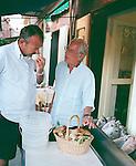 Two Italian men discussing fresh mushrooms, Liguria, Italy