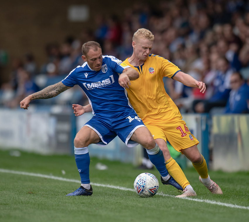 Bolton Wanderers' James Weir (right) vies for possession with Gillingham's Barry Fuller (left) <br /> <br /> Photographer David Horton/CameraSport<br /> <br /> The EFL Sky Bet League One - Gillingham v Bolton Wanderers - Saturday 31st August 2019 - Priestfield Stadium - Gillingham<br /> <br /> World Copyright © 2019 CameraSport. All rights reserved. 43 Linden Ave. Countesthorpe. Leicester. England. LE8 5PG - Tel: +44 (0) 116 277 4147 - admin@camerasport.com - www.camerasport.com