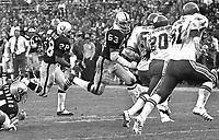 Oakland Raiders Clarence Davis running behind guard Gene Upshaw...against the Kansas City Chiefs. (1972 photo/Ron Riesterer)