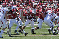 NWA Democrat-Gazette/Michael Woods --04/25/2015--w@NWAMICHAELW... University of Arkansas running back Kody Walker finds a hole in the defense during the 2015 Red-White game Saturday afternoon at Razorback Stadium in Fayetteville.