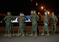 A United States Marine Corps carry team participates in the Dignified Transfer of the transfer case containing the remains of United States Marine Corps Staff Sergeant Christopher A. Slutman at Dover Air Force Base in Dover, Delaware on April 11, 2019.  he died as the result of a road-side bomb in Afghanistan on April 8, 2019. Staff Sergeant Slutman, a decorated 15 year veteran of the Fire Department of New York (FDNY), was married and had three children. Photo Credit: Ron Sachs/CNP/AdMedia