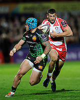 Jonny May of Gloucester Rugby looks to go inside Jack Nowell of Exeter Chiefs during the European Rugby Challenge Cup semi final match between Gloucester Rugby and Exeter Chiefs at Kingsholm Stadium on Saturday 18th April 2015 (Photo by Rob Munro)
