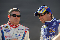 Apr 17, 2009; Avondale, AZ, USA; NASCAR Sprint Cup Series driver Bobby Labonte (left) talks with David Reutimann during qualifying for the Subway Fresh Fit 500 at Phoenix International Raceway. Mandatory Credit: Mark J. Rebilas-