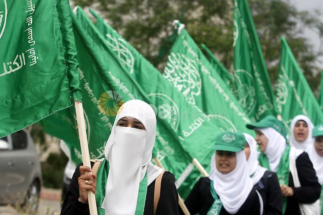 Palestinian supporters of the Islamic Hamas movement attend a rally prior to the Student Council elections at Birzeit University, on the outskirts of the city of Ramallah in the West Bank on May 6, 2014. The Student Council elections , which will take place on May 7, will pit student supporters of the top two political movements Hamas and Fatah, days after the intra-Palestinian reconciliation agreement. On April 23, the Palestine Liberation Organisation (PLO) -- internationally recognised as the sole representative of the Palestinian people -- and the Islamist Hamas which rules the Gaza Strip signed a reconciliation agreement. Photo by Issam Rimawi