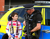 June 10th 2017, Hampden park, Glasgow, Scotland; World Cup 2018 Qualifying football, Scotland versus England; A young Scotland fan chats to one of the armed police