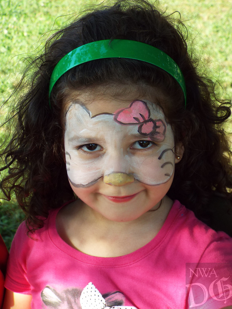 Photo by Randy Moll<br /> Vena, 5, smiles after getting her face painted at Gravette Day activities in the park on Saturday.