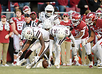 NWA Democrat-Gazette/CHARLIE KAIJO Mississippi State players recover a fumble by Arkansas running back A'Montae Spivey (24), Saturday, November 2, 2019 during the fourth quarter of a football game at Donald W. Reynolds Razorback Stadium in Fayetteville. Visit nwadg.com/photos to see more photographs from the game.