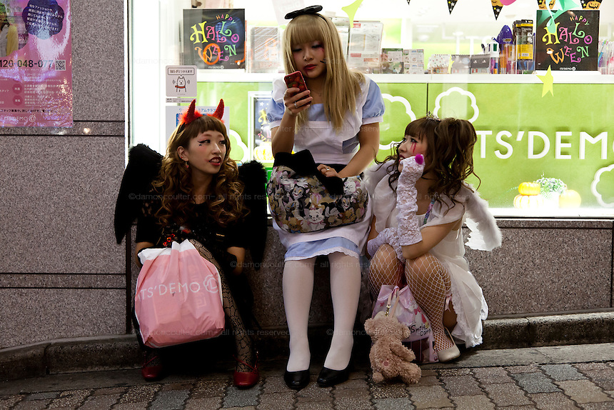 Young women dressed in costumes use a smart phone as they celebrate Halloween in Shibuya, Tokyo, Japan. Thursday, October 31st 2013