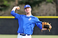 Right fielder Kep Brown (24) of the Spartanburg Methodist College Pioneers warms up before a junior college game against Surry Community College on January 31, 2016, at Mooneyham Field in Spartanburg, South Carolina. (Tom Priddy/Four Seam Images)