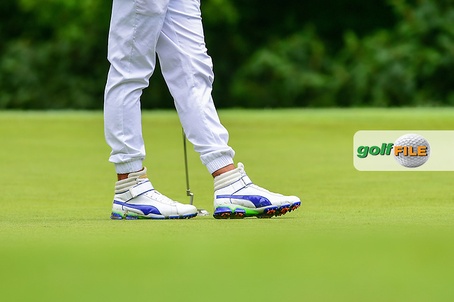 Rickie Fowler's (USA) Puma shoes as he awaits to putt on 16 during round 2 of the 2016 Quicken Loans National, Congressional Country Club, Bethesda, Maryland, USA. 6/24/2016.<br /> Picture: Golffile | Ken Murray<br /> <br /> <br /> All photo usage must carry mandatory copyright credit (&copy; Golffile | Ken Murray)