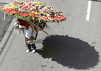 MEDELLIN, COL AUG 07. A man wears a flower arrangement in the parade Silleteros 59th in Medellin,  Colombia, on August 7, 2016. (Photo by Fredy Builes / VIEWpress)