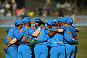 India's cricketers gather for a team talk during a T20 match between Ireland and India at the Malahide cricket club in Dublin on June 27, 2018. Photo/Paul McErlane
