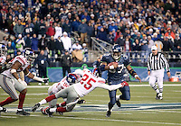 27 Nov 2005:  Seattle Seahawks running back Shaun Alexander breaks loose for a first down during overtime against the New York Giants at Quest Field in Seattle, WA.