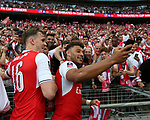 Rob Holding of Arsenal and Alex Oxlade-Chamberlain of Arsenal take a selfie with the fans during the Emirates FA Cup Final match at Wembley Stadium, London. Picture date: May 27th, 2017.Picture credit should read: David Klein/Sportimage