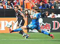 Dwayne De Rosario (7) of D.C. United goes against Jeff Parke (31) of the Philadelphia Union. The Philadelphia Union defeated D.C. United 3-2, at RFK Stadium, Sunday April 21, 2013.