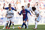 Lionel Andres Messi (C) of FC Barcelona is surrounded by Sergio Ramos (L), Toni Kroos (2nd R) and Marcelo Vieira Da Silva of Real Madrid during the La Liga 2017-18 match between Real Madrid and FC Barcelona at Santiago Bernabeu Stadium on December 23 2017 in Madrid, Spain. Photo by Diego Gonzalez / Power Sport Images