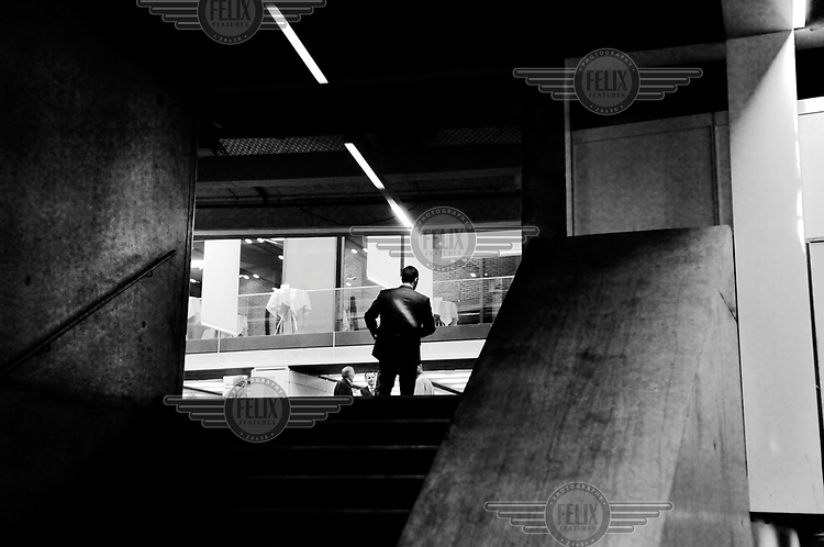 A man at the top of a flight of stairs at the annual sharehodler's meeting for UBS, Switzerland's largest bank. /Felix Features