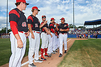 Batavia Muckdogs relief pitcher Cecil Tanner (30) fist bumps teammates including Jordan Hillyer (47), Justin Langley (55) and Ryley MacEachern (40) during introductions before a game against the State College Spikes on June 22, 2016 at Dwyer Stadium in Batavia, New York.  State College defeated Batavia 11-1.  (Mike Janes/Four Seam Images)