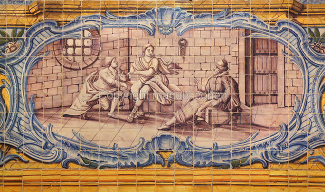 Tile scene in a decorative border, in the refectory, built 1517-18 by Leonardo Vaz, with azulejos tiles added 1780-85, of the Jeronimos Monastery or Hieronymites Monastery, a monastery of the Order of St Jerome, built in the 16th century in Late Gothic Manueline style, Belem, Lisbon, Portugal. The monastery is listed as a UNESCO World Heritage Site. Picture by Manuel Cohen