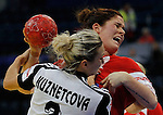 BELGRADE, SERBIA - DECEMBER 15:  Mette Gravholt (R) of Denmark is challenged by Polina Kuznetcova of Russia (L) during the Women's European Handball Championship 2012 fifth place match between Denmark and Russia at Arena Hall on December 15, 2012 in Belgrade, Serbia. (Photo by Srdjan Stevanovic/Getty Images)