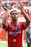 Lyle Taylor of Charlton celebrates their victory and promotion to the Championship as he applauds the Charlton fans during Charlton Athletic vs Sunderland AFC, Sky Bet EFL League 1 Play-Off Final Football at Wembley Stadium on 26th May 2019