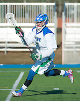 Luc Copeland,'18, charges for the goal during men's lacrosse action against Anna Maria at Gaudet Field in Middletown.