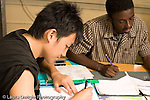 Education High School Mathematics class two male students at work horizontal