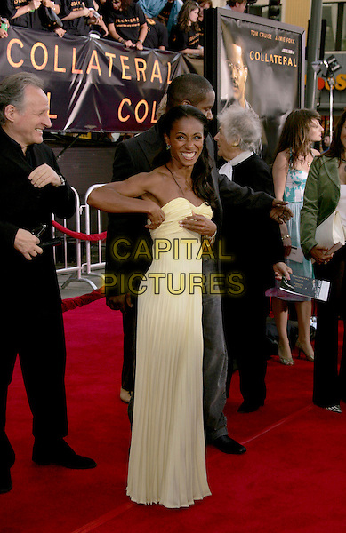 """JADA PINKETT SMITH.The Los Angeles Premiere of """"Collateral"""" held at The historic Orpheum Theatre in Downtown Los Angeles, California .August 2,2004.full length, cream, white, yellow strapless dress, pleated, folds.www.capitalpictures.com.sales@capitalpictures.com.Supplied By Capital Pictures"""