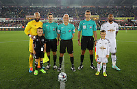 Pictured: Tim Howard of Everton with Ashley Williams of Swansea pose with match officials and children mascots before kick off. Tuesday 23 September 2014<br />
