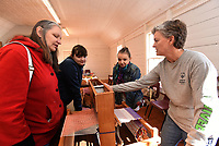 NWA Democrat-Gazette/FLIP PUTTHOFF <br /> EAGER WEAVERS<br /> Kristine Servis (from left) of Springdale and her daughters, Marian and Lilliyanna Servis, learn Saturday March 16 2019 how a loom operates during a weaving workshop at Shiloh Museum of Ozark History in downtown Springdale. Judy Costello with the museum staff shows how a loom works. Members of the Northwest Arkansas Handweavers Guild hosted the workshop as part of the museum's Family Fun Day. The guild was founded in 1949 and started the first War Eagle Fair in 1954 with a show of their handiwork, said Laura Redford, guild member.