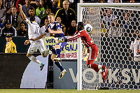 LA Galaxy midfielder & captain Landon Donovan attempts to head a ball past Bouna Coundoul GK of the New York Red Bulls and defender Tim Ream. The New York Red Bulls beat the LA Galaxy 2-0 at Home Depot Center stadium in Carson, California on Friday September 24, 2010.