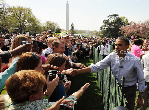 United States President Barack Obama greets guests on the South Lawn during the White House Easter Egg Roll in Washington on Monday, April 5, 2010.   .Credit: Roger L. Wollenberg / Pool via CNP