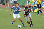July 22 2007:  Jose Cancela (9) of the Rapids gets the ball past Sasha Victorine (9) of the Wizards.  The MLS Kansas City Wizards tied the visiting Colorado Rapids 2-2 at Arrowhead Stadium in Kansas City, Missouri, in a regular season league soccer match.