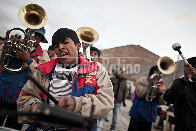 A picture dated Friday January 25, 2013 shows a young member of a music band playing the day before the Miners Carnival in the Andes city of Potosi in Bolivia.  Already in 1663 the Spanish chronicler Marquez Jerez de los Caballeros described the colorful  miners carnival in Potosi. Four centuries later, the tradition of the legendary Cerro Rico miners is  still alive ..