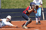 Centennial's Mia Acuna scores past Coronado catcher Katie Cochran during the state championship softball tournament at the University of Nevada, Reno, in Reno, Nev., on Saturday, May 20, 2012. .Photo by Cathleen Allison
