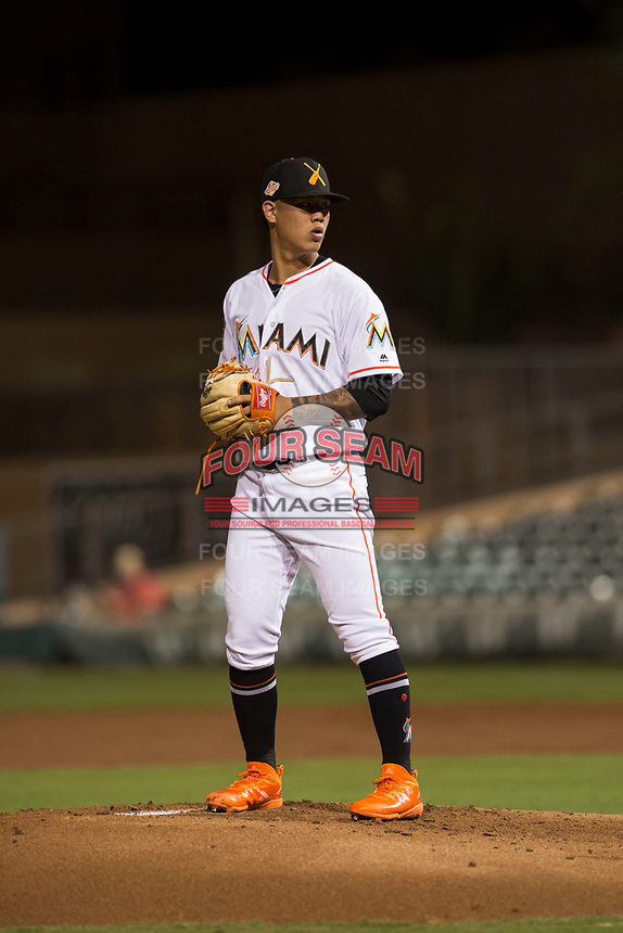 Salt River Rafters starting pitcher Jordan Yamamoto (20), of the Miami Marlins organization, gets ready to deliver a pitch during an Arizona Fall League game against the Scottsdale Scorpions at Salt River Fields at Talking Stick on October 11, 2018 in Scottsdale, Arizona. Salt River defeated Scottsdale 7-6. (Zachary Lucy/Four Seam Images)