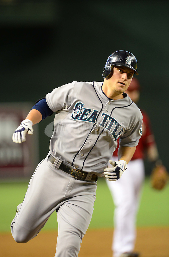 Jun. 20, 2012; Phoenix, AZ, USA; Seattle Mariners batter Kyle Seager rounds the bases after hitting a two run home run in the third inning against the Arizona Diamondbacks at Chase Field.  Mandatory Credit: Mark J. Rebilas-
