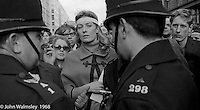 Vanessa Redgrave leads the march, anti-Vietnam war demonstration from Trafalgar Sq to Grosvenor Sq Sunday 17th March 1968.  A young Richard Branson is just visible to her left.  At the time, I think he was editor of a student magazine.  I was told the headband was a Vietnamese sign of mourning for dead children.