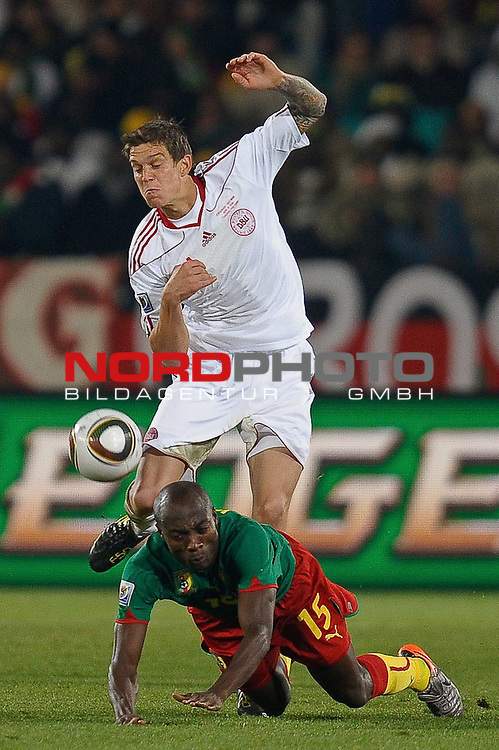 19.06.2010, Loftus Versfeld Stadium, Pretoria, RSA, FIFA WM 2010, Cameroon (CMR) vs Denmark (DEN), im Bild Daniel Agger of Denmark in action with Pierre Webo of Cameroon.  Foto: nph /    Marc Atkins *** Local Caption *** Fotos sind ohne vorherigen schriftliche Zustimmung ausschliesslich f&uuml;r redaktionelle Publikationszwecke zu verwenden.<br /> <br /> Auf Anfrage in hoeherer Qualitaet/Aufloesung