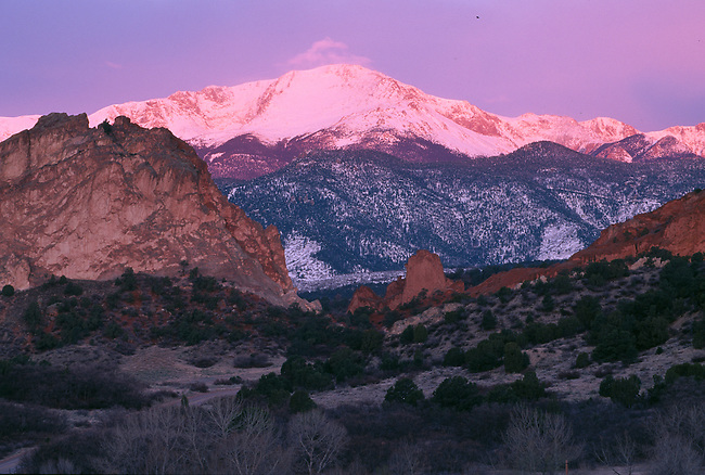 Colorful sunrise glow on Pikes Peak from Garden of the Gods park, Colorado Springs, CO