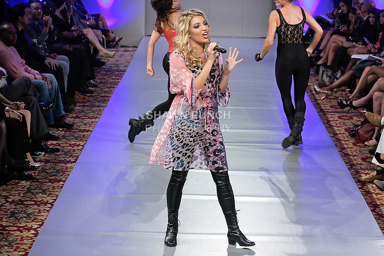 Austrian singer Dalal Bruchmann, performs at the Waldolf-Astoria Hotel's Grand Ballroom, in New York City, during Couture Fashion Week, September 18, 2011.