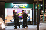 © Joel Goodman - 07973 332324. 26/09/2017. Brighton, UK. Police detain , handcuff , bind the legs and put a hood over the head of a man outside a branch of Subway , before carrying him in to the back of a police van , after a fight in Steine Gardens in the Kemptown area of the city . Revellers at the end of a night out in Brighton during Freshers week , when university students traditionally enjoy the bars and clubs during their first nights out in a new city . Photo credit : Joel Goodman