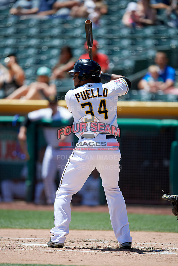Cesar Puello (34) of the Salt Lake Bees bats against the Albuquerque Isotopesin Pacific Coast League action at Smith's Ballpark on June 11, 2017 in Salt Lake City, Utah. The Bees defeated the Isotopes 6-5. (Stephen Smith/Four Seam Images)